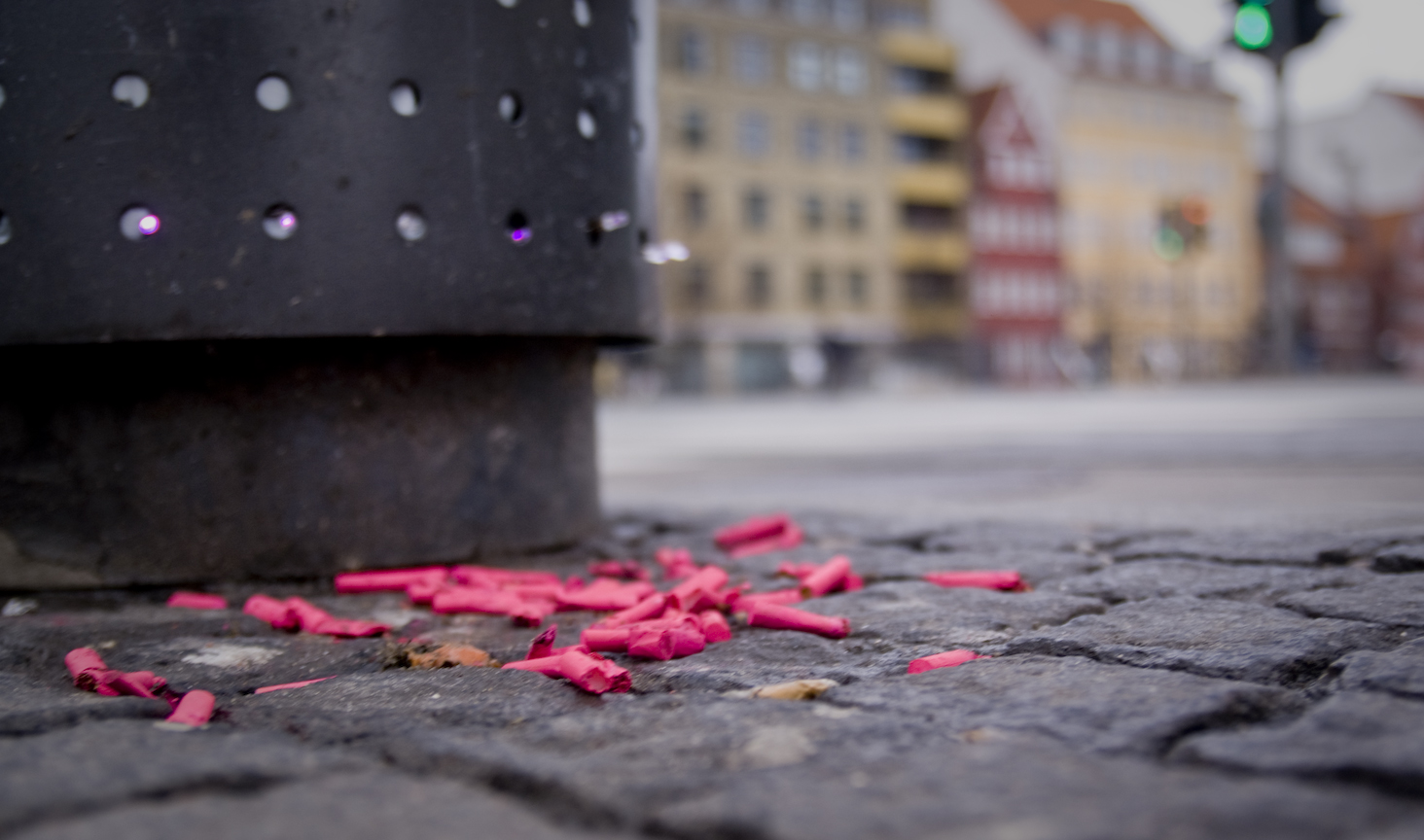 Trash attack Copenhagen pink trash on ground cigerate